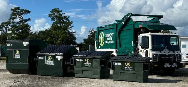 Photo of Trident Waste SC truck with 2, 4, 6, and 8 yard containers